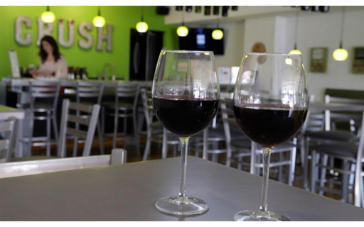 Two wine glasses on a table at crush wine bar.