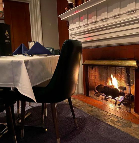 A table by the fireplace at Eric's Porter Haus.