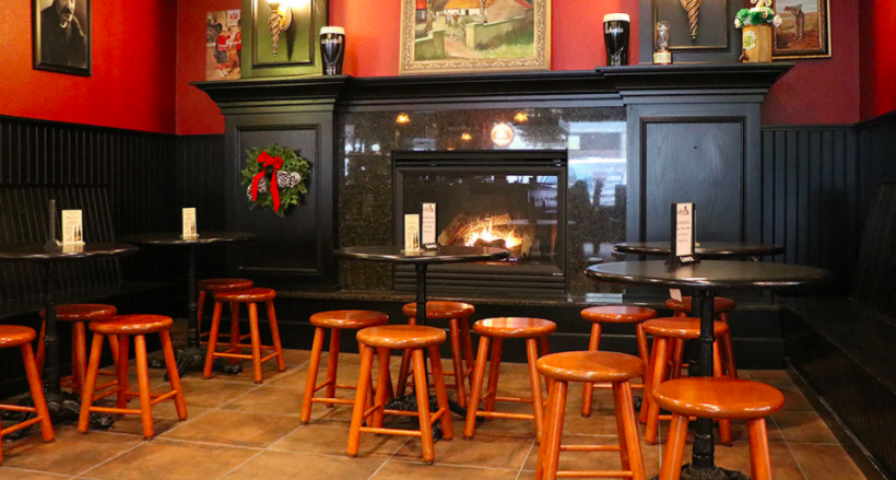 Tables by the fireplace at Five Points Irish Pub.