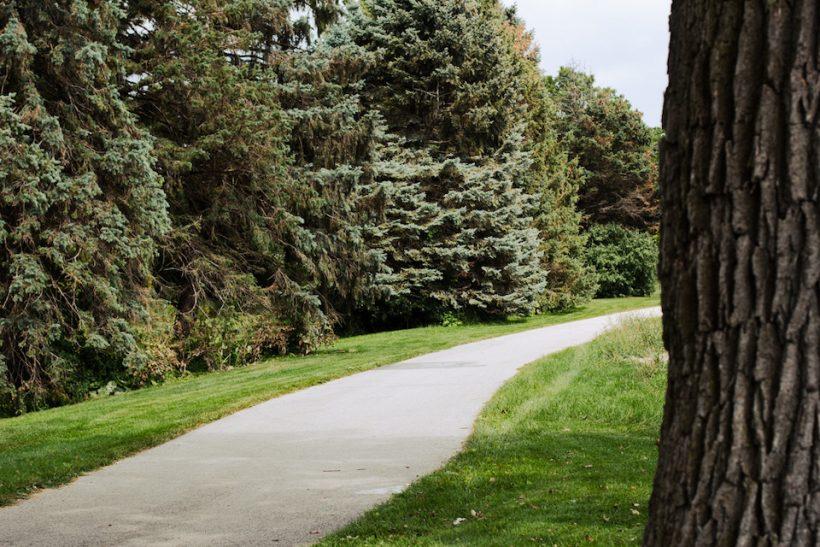 A walking path in a waukesha park.